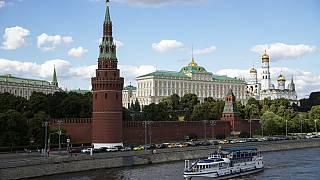 A tourist boat passes the Kremlin in Moscow, Russia.