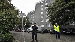 Police secure the entrance of a house where five dead children were found in Solingen, Germany