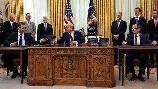 US President Donald Trump with Serbian President Aleksandar Vucic, left, and Kosovar Prime Minister Avdullah Hoti, in the Oval Office of the White House, Sept. 4, 2020.