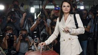 In this Aug. 9, 2020, file photo, Sviatlana Tsikhanouskaya casts her ballot at a polling station during the presidential election in Minsk, Belarus.