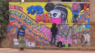 Street artists fight COVID-19 with art in Rwanda