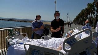 After months in ICU, a patient takes in the sea view in Barcelona