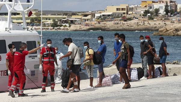 Authorities move hundreds of migrants from overcrowded centre on Italian island of Lampedusa