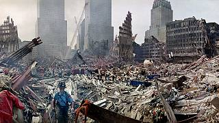 Rescue workers examine the site of the Sept. 11, 2001 World Trade Center terrorist attacks in New York