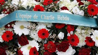 A wreath of flowers outside Charlie Hebdo's former offices in January this year.