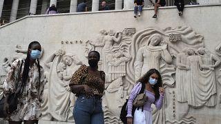Women walk at The Palais de Tokyo Museum wearing a protective face mask as a precaution against the coronavirus in Paris, Saturday, Sept. 5, 2020.