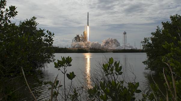 In this photo provided by NASA, the SpaceX Falcon 9 rocket  launches from pad 39A at NASA's Kennedy Space Center in Cape Canaveral, Florida.