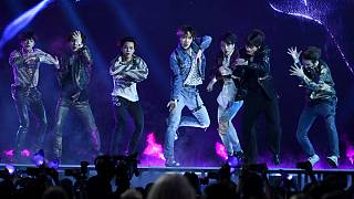 "BTS performs ""Fake Love"" , ""Dynamite"" was the group's first all-English song"