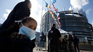 People wait in line to be tested for the COVID-19 outside the European Parliament in Strasbourg, eastern France, Tuesday, May 12, 2020.