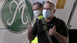 In this image made from a video, The Australian Financial Review journalist Michael Smith on his arrival at Sydney airport, Australia Tuesday, Sept. 8, 2020.