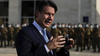 Italian Prime Minister Giuseppe Conte speaks to journalists as he visits an Italian field hospital set up at the Lebanese University in the Hadath district of Beirut, Lebanon,