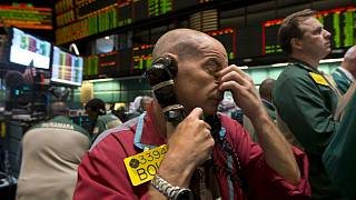 Traders work in the oil options pit at the New York Mercantile Exchange
