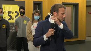 French President Emmanuel Macron coughs while speaking to students in Clermont-Ferrand. September 9, 2020.