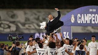 Real Madrid's players throw on the air their head coach Zinedine Zidane, as they celebrate after winning the Spanish La Liga 2019-2020