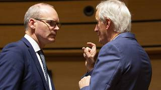 European Union chief Brexit negotiator Michel Barnier, right, speaks with Irish Foreign Minister Simon Coveney, left, during meeting of EU General Affairs ministers, Oct 2019