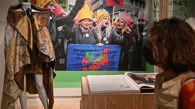 """Visitors look at outfits at the exhibition """"Art, Fashion and Subversion"""" by British fashion designer Vivienne Westwood"""