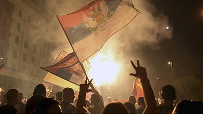 Pro-opposition supporters celebrate the election results in Podgorica, Montenegro, early in the morning on August 31, 2020.