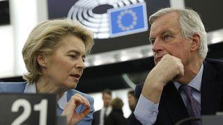 European Commission President Ursula von der Leyen, left, talks to to European Union chief Brexit negotiator Michel Barnier