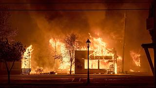 Buildings are engulfed in flames as a wildfire ravages the Oregon town of Talent on September 8, 2020.