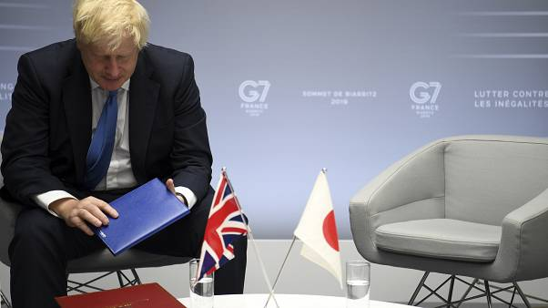 FILE: Boris Johnson sits after bilateral talks with Japanese Prime Minister Shinzo Abe during the G7 summit in Biarritz, southwestern France, Aug. 26, 2019
