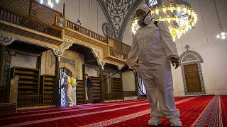 Disinfection team disinfect the premises of the grand mosque in capital Pristina, Kosovo.