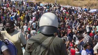 Thousands of migrants, refugees protest in Lesbos