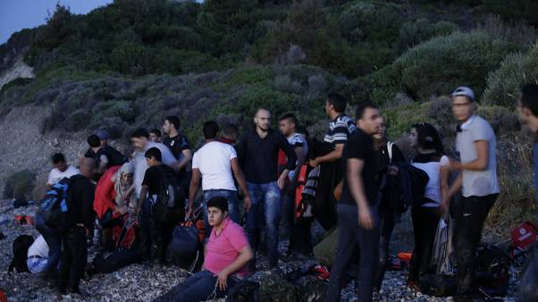 FILE: Syrian migrants arrive from Turkish coasts at a beach in Mytilene, on the northeastern Greek island of Lesvos, June 16, 2015.