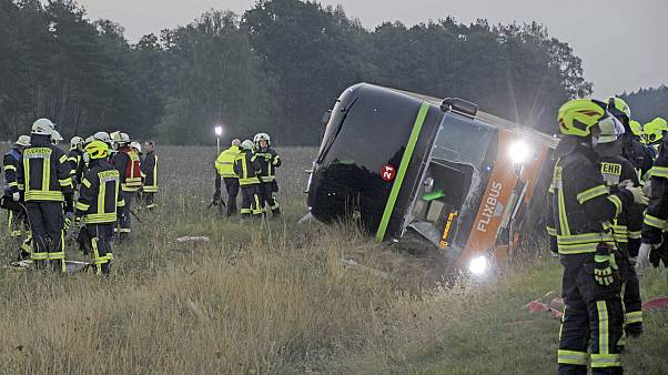 Firefighters are standing next to a long-distance bus on the A24 motorway in Woebbelin, northern Germany.