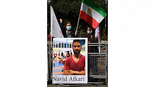 Demonstraters against the execution of Iranian wrestler Navid Afkari gather outside the Iranian embassy in London on September 12, 2020.