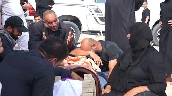 عراقيون يعيدون دفن ضحايا كورونا بمقابر عائلية