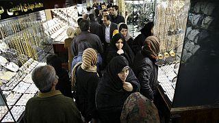 Iranians walk at the gold market of Tehran's old main bazaar, Iran
