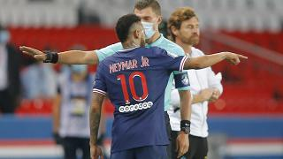 PSG's Neymar argues with the fourth official as he leaves the pitch after getting a red card during the French Ligue 1 match between PSG and OM in Paris, Sept.13, 2020.