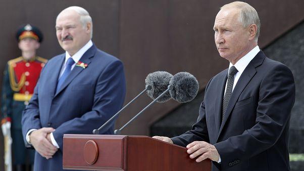 Russian President Vladimir Putin, right, and Belarusian President Alexander Lukashenko at public ceremony, in the village of Khoroshevo, Russia, 30, 2020