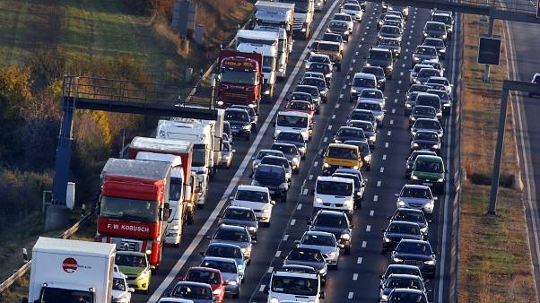 In this Nov. 6, 2017 file photo cars and trucks queue on the highway A5 in Frankfurt, Germany.