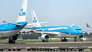 KLM aircrafts are seen at a standstill on the tarmac of Schiphol airport in April.