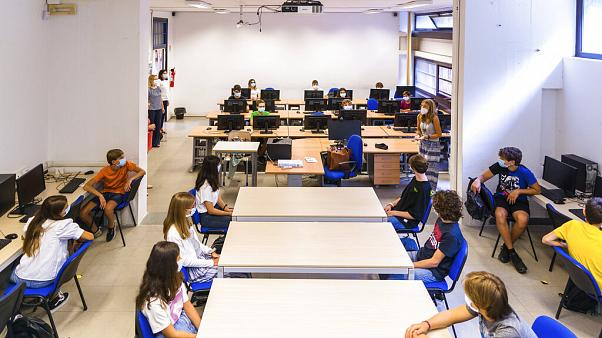 Pupils listen to teachers on their first day of school at the high school Giovanni Battista Morgagni in Rome, Monday, Sept. 14, 2020