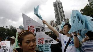 FILE: Thousands of people march in a Hong Kong downtown street, July 1, 2007.