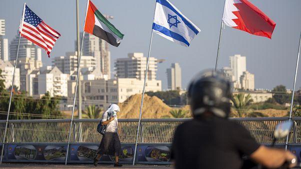 American, United Arab Emirates, Israel and Bahraini flags fly at the Peace Bridge in Netanya, Israel, Monday, Sept. 14, 2020.