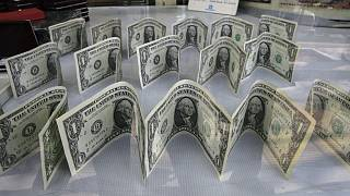 US dollars decorate a foreign currency exchange bureau, in Ferdowsi St. in downtown Tehran, Iran