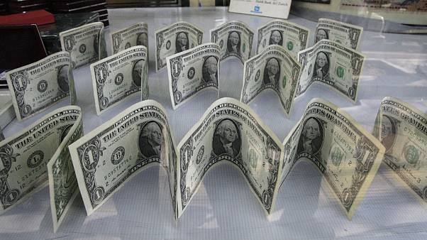 US dollars decorate a foreign currency exchange bureau, in Ferdowsi St. in downtown Tehran, Iran
