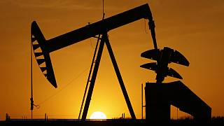 A pumpjack is silhouetted against the setting sun in Oklahoma City
