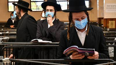 Hasidic Jews wearing face masks to protect against the coronavirus disease observe social distance as they visit the tomb of Rabbi Nahman in Uman, Ukraine, Sept 15, 2020.
