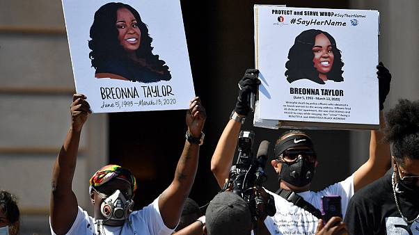 Signs are held up showing Breonna Taylor during a rally in her honour on the steps of the Kentucky State Capitol in Frankfort, Ky., Thursday, June 25, 2020.