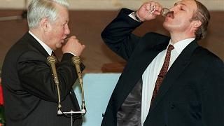 Boris Yeltsin, left, and Belarusian President Alexander Lukashenko drink vodka after a toast celebrating the signing of an agreement in the Kremlin in Moscow. 2 April 1996