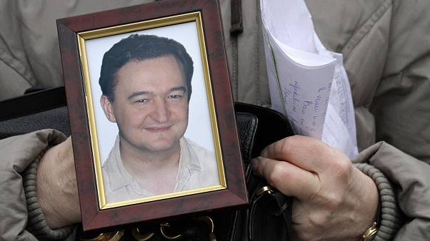 A portrait of lawyer Sergei Magnitsky, who died in a Russian jail in 2009 and whose name inspired anti-corruption laws around the world