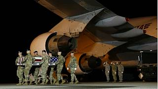 A U.S. Army carry team moves a transfer case containing the remains of Sgt from Afghanistan.