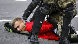 A protester is detained in Minsk during a Belarusian opposition supporters' rally on September 13