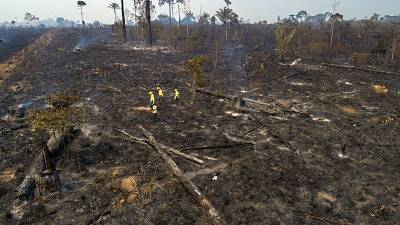 Experts say fires are pushing the world's largest rainforest toward a tipping point, after which it will cease to generate enough rainfall to sustain itself.