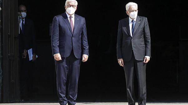 German President Frank-Walter Steinmeier, is flanked by Italian President Sergio Mattarella after visiting the Duomo gothic cathedral, in Milan, Italy, Sept. 17, 2020