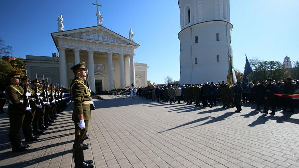 An honor guard stand as the coffin of the commander of the 1944-1953 partisan resistance movement against Soviet occupation, Adolfas Ramanauskas.